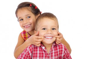 Two funny smiling little children
